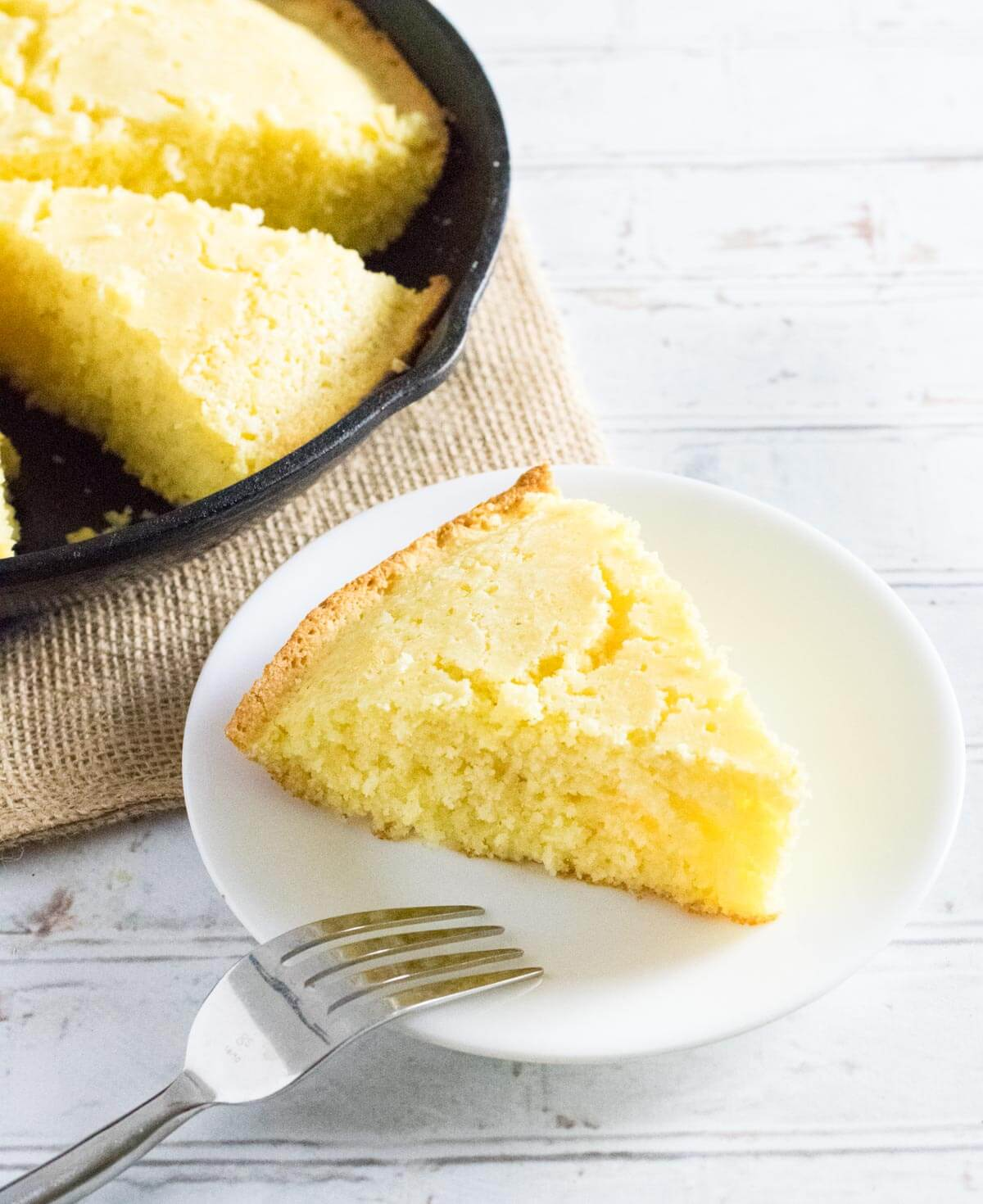 Cornbread without buttermilk on a white plate.