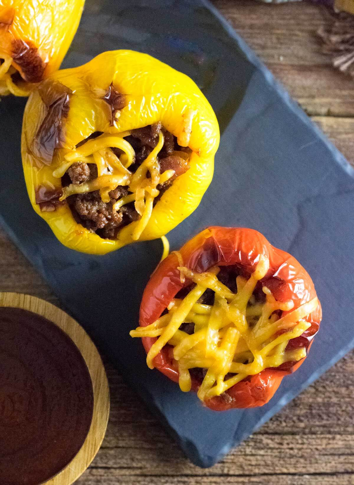 BBQ beef stuffed peppers topped with cheese.