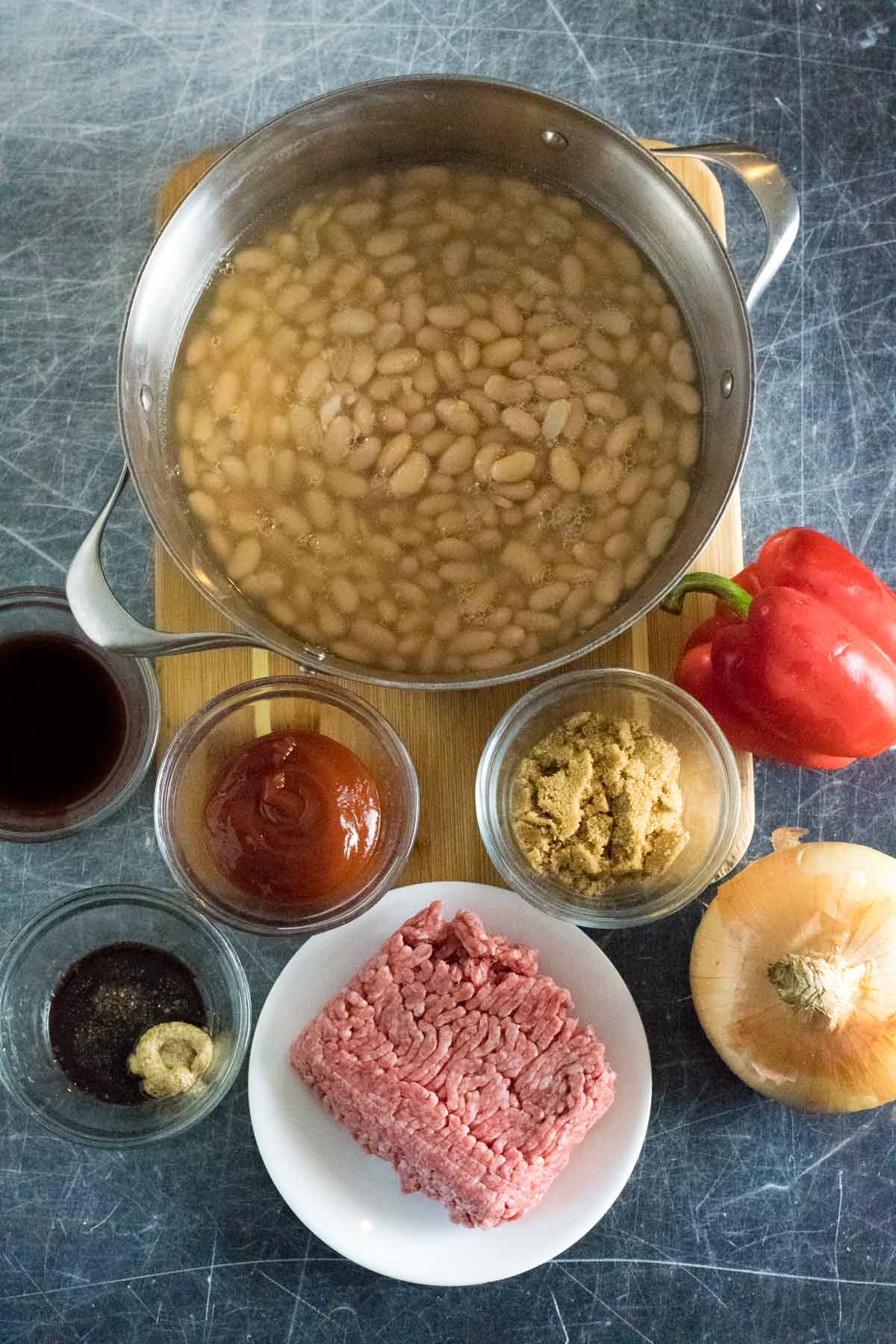 Ingredients for baked beans in separate bowls.
