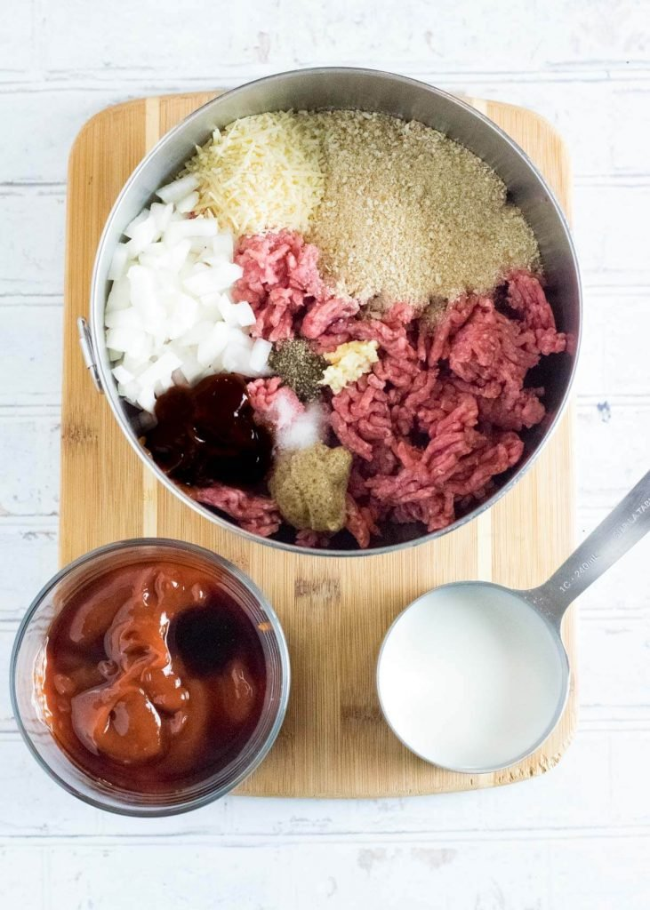 Meatloaf ingredients without eggs shown in mixing bowl.
