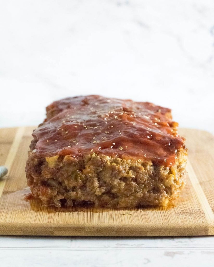 Meatloaf without eggs on cutting board.