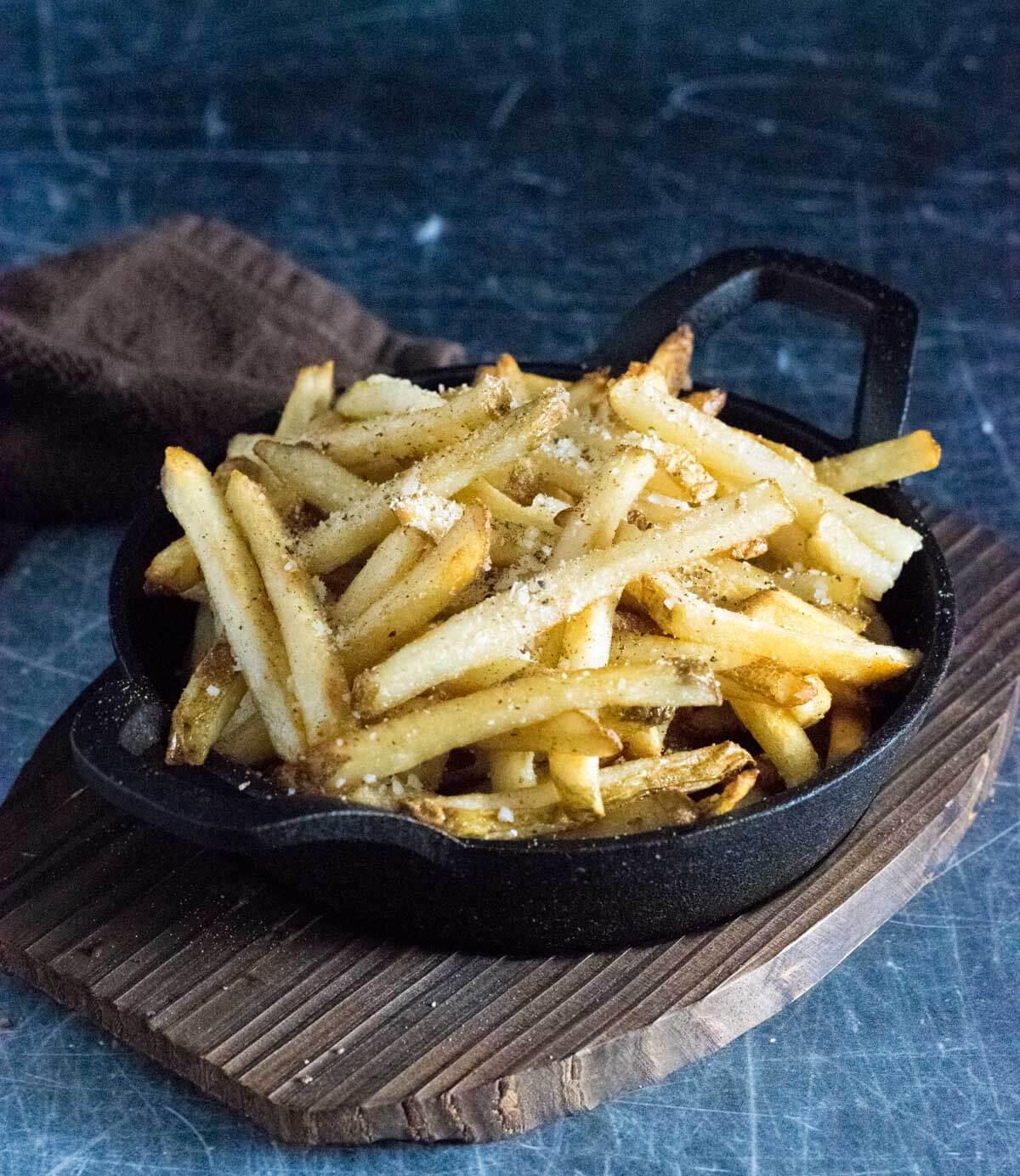 Truffle fries in dish.